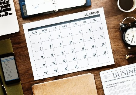 Calendar showing dates to sell or buy property on.
